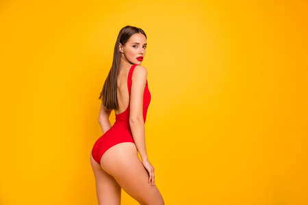Photo pour Profile side view portrait of nice-looking attractive glamorous lovely adorable posh sportive straight-haired lady perfect figure juicy shape form line isolated on bright vivid shine yellow background - image libre de droit