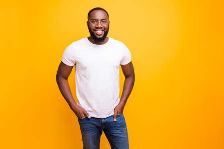 Foto de Young guy with dark skin wearing casual outfit on yellow background - Imagen libre de derechos
