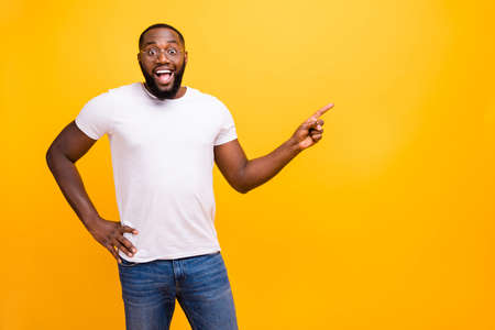 Foto de Young guy with dark skin wearing casual outfit on yellow background - Imagen libre de derechos