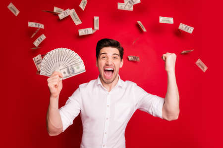Photo for Photo of brunet white wealthy rich man enjoying his success while isolated with red background - Royalty Free Image