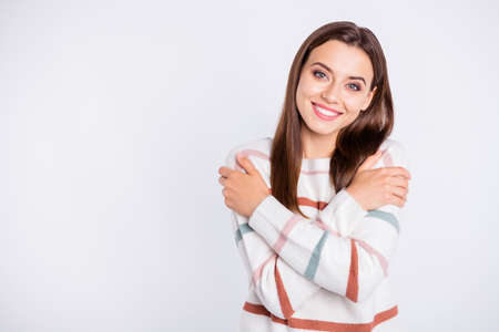 Photo pour Photo of amazing lady crossing hands touching nice striped pullover isolated white background - image libre de droit