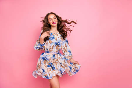 Foto de Nice lady overjoyed by warm spring breeze close eyes wear cute dress isolated pink background - Imagen libre de derechos