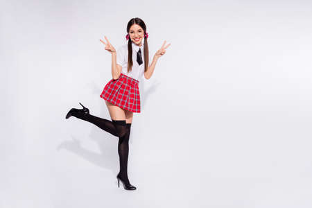 Photo pour Full length body size photo beautiful she her model lady tails groupmates return school v-sign hands arms say hi positive wear red checkered plaid costume pantyhose tie isolated white background - image libre de droit