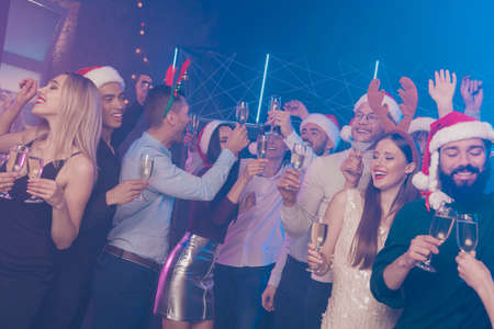 Photo for Portrait of nice-looking attractive glamorous gorgeous cheerful cheery funny positive girls and guys having fun nightlife winter December tradition in luxury place nightclub - Royalty Free Image