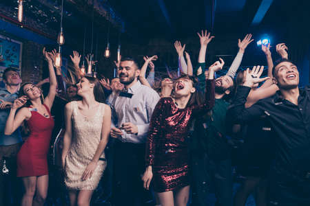 Photo for Portrait of charming attractive millennial motion having scream shout rejoice raise hands free time indoors discotheque dress suit formalwear hairstyle - Royalty Free Image