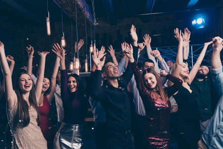 Photo for Portrait of excited good-looking magnificent fellows people millennial raise hands scream laughter rejoice content indoors disco suit dress formalwear formal wear - Royalty Free Image