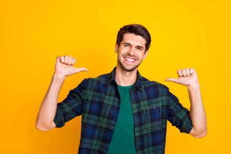 Foto de I am best. Photo of amazing guy indicating thumb fingers on himself wear casual checkered shirt isolated yellow color background - Imagen libre de derechos