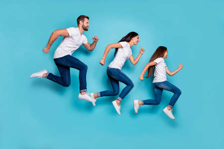 Photo pour Full length body size photo of running sporty family being healthy and beautiful while isolated with blue background - image libre de droit