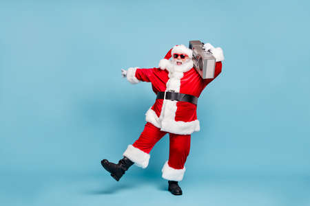 Photo for Full length body size view of his he nice cool fat cheerful cheery glad excited carefree bearded Santa clubber carrying tape player dancing clubbing isolated on blue turquoise pastel color background - Royalty Free Image