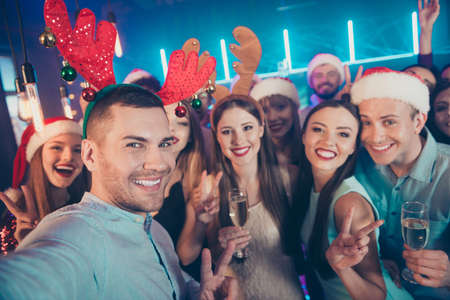 Photo for Close up photo portrait of positive carefree having good time at eve x-mas taking selfie  in santa claus hat raising glass sating toast for upcoming year 2020 - Royalty Free Image