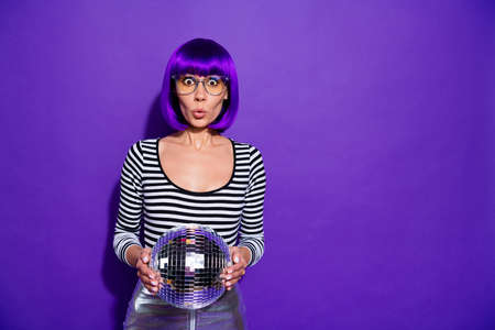 Photo for Portrait of impressed lady with eyewear eyeglasses holding mirror ball isolated over purple violet background - Royalty Free Image