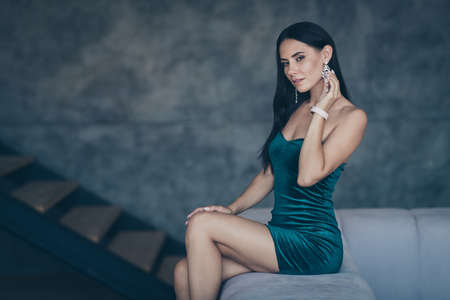 Foto de Profile photo of tenderness lady sitting on comfy modern sofa remembering last ideal love night touch earring ear wear formalwear shiny short mini dress apartments indoors - Imagen libre de derechos