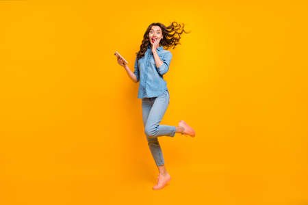Photo pour Full length body size photo of cheerful crazy sweet pretty girlish feminine youngster overjoyed about having received long expected message holding phone expressing emotions isolated vivid color background - image libre de droit