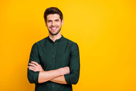 Photo pour Portrait of confident cool entrepreneur guy cross hands look feel positive cheerful emotions real professional expert wear casual style clothing isolated over yellow color background - image libre de droit