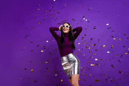 Photo pour Photo of cheerful cute pretty nice charming attractive girl hanging out in night club in skirt isolated vibrant dancing purple color background - image libre de droit