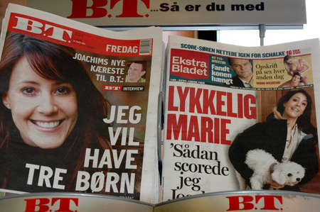 Foto de Danish toblaid BT and Ekstra Bladet with same cover stories Prince Joachims new lady friend, Marie she iw French born and lives in Switzerland 30 years old,newly in love with Joachim, Copenhagen Denmark March 17,2006 - Imagen libre de derechos