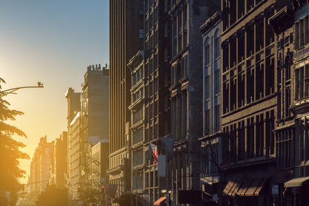 Photo pour Sunset light shines on a block of buildings in New York City NYC - image libre de droit
