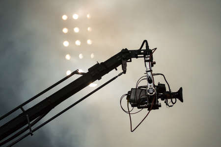 Photo for TV camera on a crane on football mach or concert - Royalty Free Image