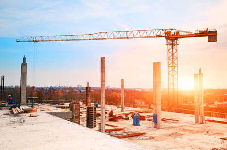 Foto de tower crane at construction site in morning sunlight - Imagen libre de derechos