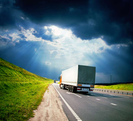 Photo pour trucks under colorful sky - image libre de droit