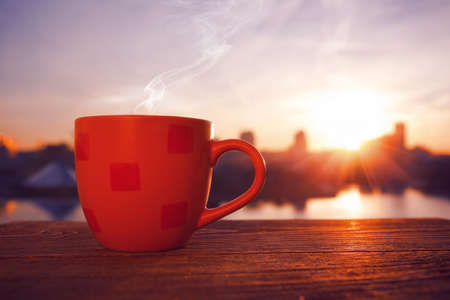 Foto de morning coffee with city view in sunrise - Imagen libre de derechos