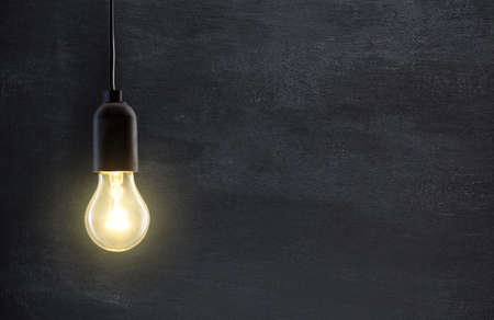 Photo for Light bulb lamp on blackboard background with copy space - Royalty Free Image