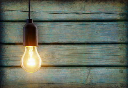 Foto per Light bulb lamp on wooden background with copy space - Immagine Royalty Free