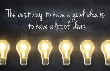 Foto per Light bulb lamps on blackboard background with idea quote - Immagine Royalty Free