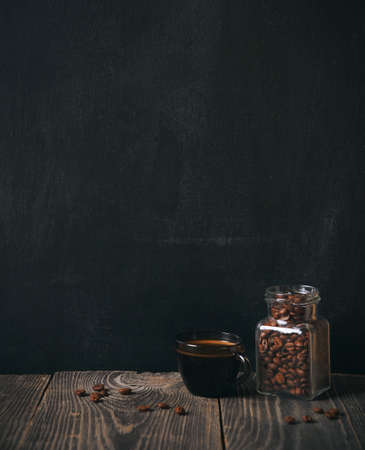 Foto de coffee and beans on blackboard background. copy space - Imagen libre de derechos