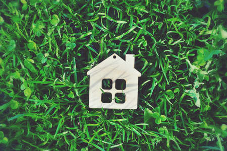 Photo for wooden house as symbol in the green grass - Royalty Free Image