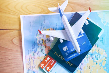 Photo for Air tickets, passports and credit card on world map. Online ticket booking and holiday planning concept - Royalty Free Image