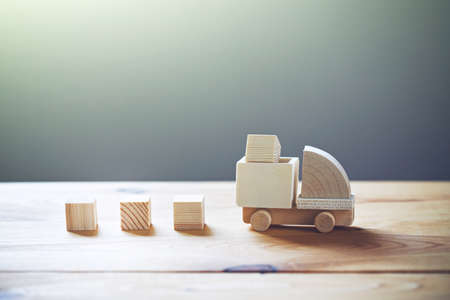Foto de Wooden model of truck loading freight. Shipping and delivery concept - Imagen libre de derechos