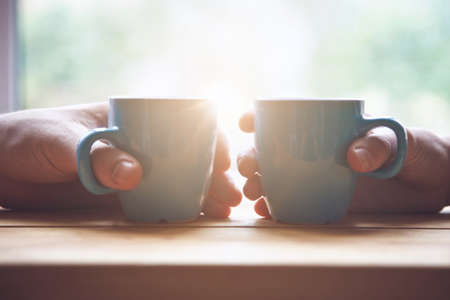 Photo pour couple with two cups of morning coffee on sunrise light - image libre de droit