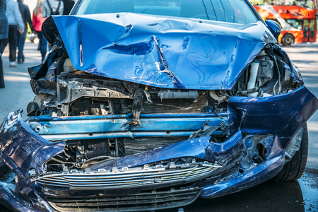 Foto per Crashed car after accident on road, dangerous driving concept - Immagine Royalty Free