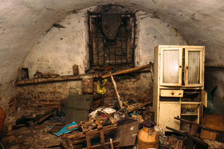 Photo pour Old abandoned dirty shelter or basement of homeless people, old furniture and trash - image libre de droit