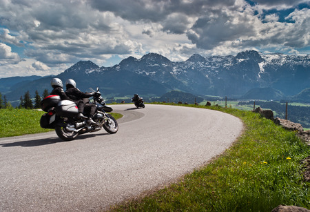 Photo pour Motorbikes on the road in mountains with Alps in background Salzkammergut,Austria  - image libre de droit