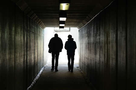 Foto per Two persons walk to the light at the end of the tunnel - Immagine Royalty Free