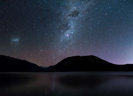Photo pour Amazing Starry night at Lake Rotoiti. Reflection of the Milky way and galaxy on the lake. Nelson Lake National Park, New Zealand. - image libre de droit