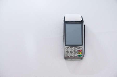 Foto de New modern payment terminal on gray background - Imagen libre de derechos