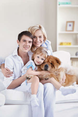 Family with pets at home