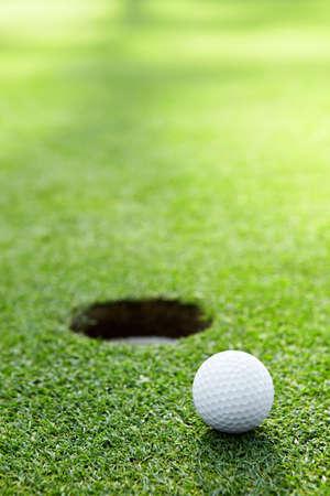 A golf ball at the hole
