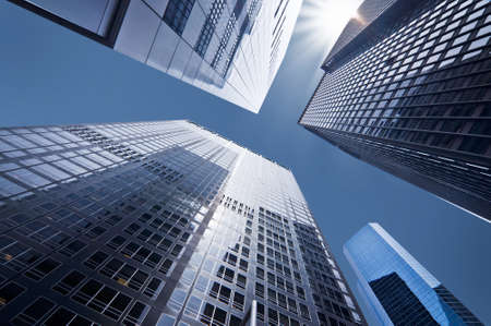 Photo pour Looking up at business buildings in downtown New York, USA - image libre de droit
