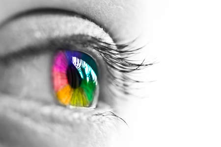 Photo pour Girl colorful and natural rainbow eye on white background - image libre de droit