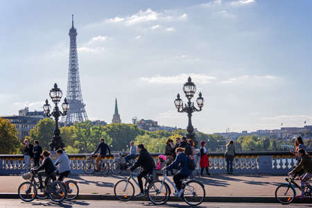 Foto de People on bicycles and pedestrians enjoying a car free day on Alexandre III bridge in Paris, France - Imagen libre de derechos