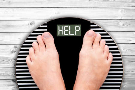 Foto de Word Help written on a weight scale - Imagen libre de derechos