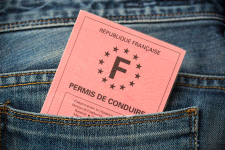 Photo for French driving license in the rear pocket of blue jeans, driving licence test concept - Royalty Free Image
