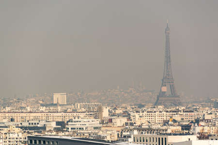Foto de Aerial view of the Eiffel tower in the fog in Paris. City air pollution concept - Imagen libre de derechos