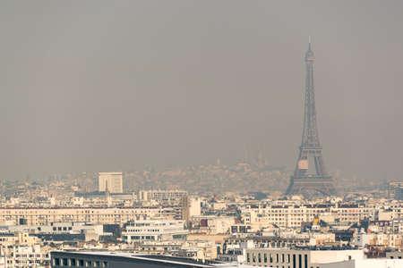 Photo pour Aerial view of the Eiffel tower in the fog in Paris. City air pollution concept - image libre de droit
