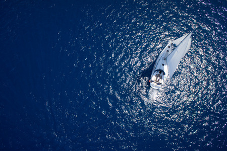 Photo pour Amazing view to Yacht sailing in open sea at windy day. Drone view - birds eye angle - image libre de droit