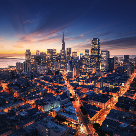 Foto de San Francisco aerial view from sea side. Port of San Francisco in the front. City downtown and skyscrapers at sunrise. - Imagen libre de derechos